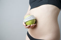 Female body with green apple Stock Photo