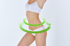 Female body with the green drawing arrows Stock Photography