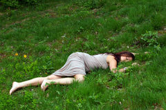 Female body lying in grass Stock Photography