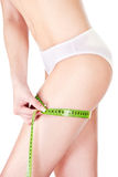 Female body and measure tape Royalty Free Stock Image