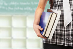 Female body part holding book Stock Images