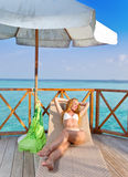 The female body sunbathes against the sea Royalty Free Stock Photography