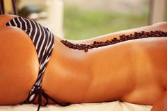 Female body in swimming suit at the spa with coffee Royalty Free Stock Photography