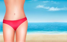 Female body in a swimsuit in front of a seaside background. Stock Image