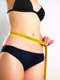 Female body with tape measure Royalty Free Stock Photo