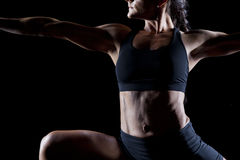 Female bodybuilder. Working out isolated on black Royalty Free Stock Photo