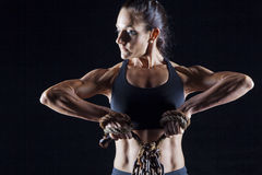 Female bodybuilder. Working out  on black Royalty Free Stock Images