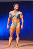 Female bodybuilder celebrates her championship victory on stage Royalty Free Stock Images