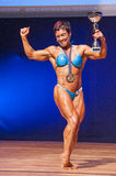 Female bodybuilder celebrates her championship victory on stage Royalty Free Stock Image