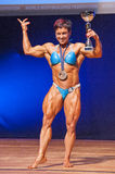 Female bodybuilder celebrates her championship victory on stage Royalty Free Stock Photography