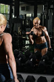 Female Bodybuilder Doing Heavy Weight Exercise For Biceps Royalty Free Stock Image