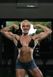 Female Bodybuilder Flexing Muscles Royalty Free Stock Photos