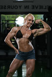 Female Bodybuilder Flexing Muscles Stock Photos
