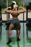 Female Bodybuilder Flexing Muscles Royalty Free Stock Images