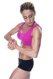 Female bodybuilder flexing in pink sports bra Royalty Free Stock Image