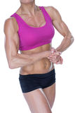 Female bodybuilder flexing in sports bra and shorts Royalty Free Stock Photos