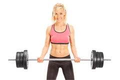 Female bodybuilder holding a barbell. Isolated on white background Royalty Free Stock Images