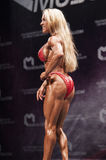 Female bodybuilder model showing het best on stage Stock Photography