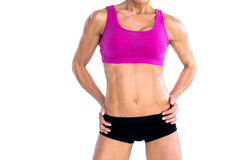 Female bodybuilder posing with hands on hips mid section Royalty Free Stock Photography