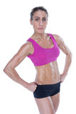 Female bodybuilder posing with hands on hips mid section Royalty Free Stock Photo