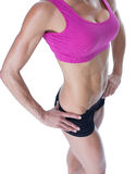 Female bodybuilder posing with hands on hips mid section Stock Photo