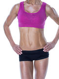 Female bodybuilder posing with hands on hips mid section Royalty Free Stock Image