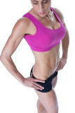 Female bodybuilder posing in pink sports bra and shorts Stock Photography