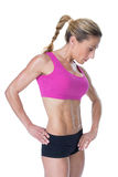 Female bodybuilder posing in pink sports bra Royalty Free Stock Photography