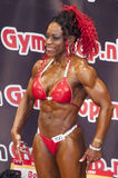 Female bodybuilder with red bikini Stock Photography