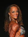 Female Bodybuilder Roars into Middle Age Stock Image