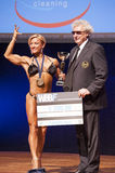 Female bodybuilders celebrate their championship victory on stag Royalty Free Stock Photo