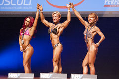 Female bodybuilders celebrate their championship victory on stag Royalty Free Stock Images