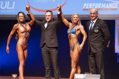 Female bodybuilders celebrate their championship victory on stag Stock Image