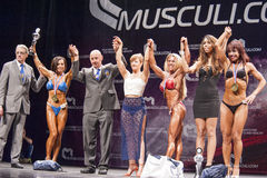 Female bodybuilders celebrate their victory with officials on st Royalty Free Stock Images