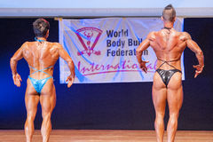 Female bodybuilders flex their muscles to show their physique Stock Image