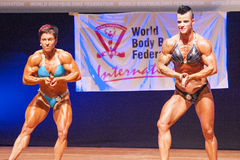 Female bodybuilders flex their muscles to show their physique Stock Images