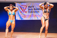 Female bodybuilders flex their muscles to show their physique Stock Photo