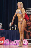 Female bodybuildershows het best front pose on stage Royalty Free Stock Image