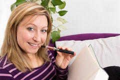 Female with book and e-cigarette Stock Photo