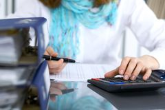 Female bookkeeper or financial inspector  making report, calculating or checking balance. Internal Revenue Servic Royalty Free Stock Image