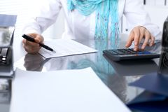 Female bookkeeper or financial inspector  making report, calculating or checking balance. Internal Revenue Servic Royalty Free Stock Images