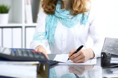Female bookkeeper or financial inspector  making report, calculating or checking balance. Internal Revenue Servic Stock Images
