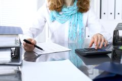 Female bookkeeper or financial inspector  making report, calculating or checking balance. Internal Revenue Servic Royalty Free Stock Photo