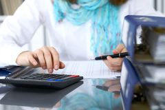 Female bookkeeper or financial inspector  making report, calculating or checking balance. Internal Revenue Servic Royalty Free Stock Photos