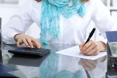Female bookkeeper or financial inspector  making report, calculating or checking balance. Internal Revenue Servic Stock Image