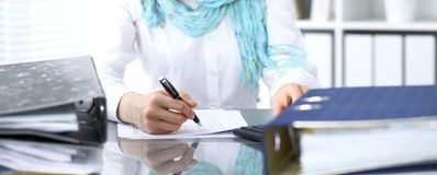 Female bookkeeper or financial inspector  making report, calculating or checking balance. Internal Revenue Servic Stock Photo