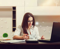 Female bookkeeper in glasses working at the table. Accountant at workplace concept stock images