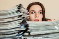 Female bookkeeper with large stacks of documents Stock Images