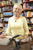Female bookshop proprietor. Smiling at camera Stock Images