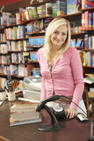 Female bookshop proprietor. Looking happy and relaxed Royalty Free Stock Image